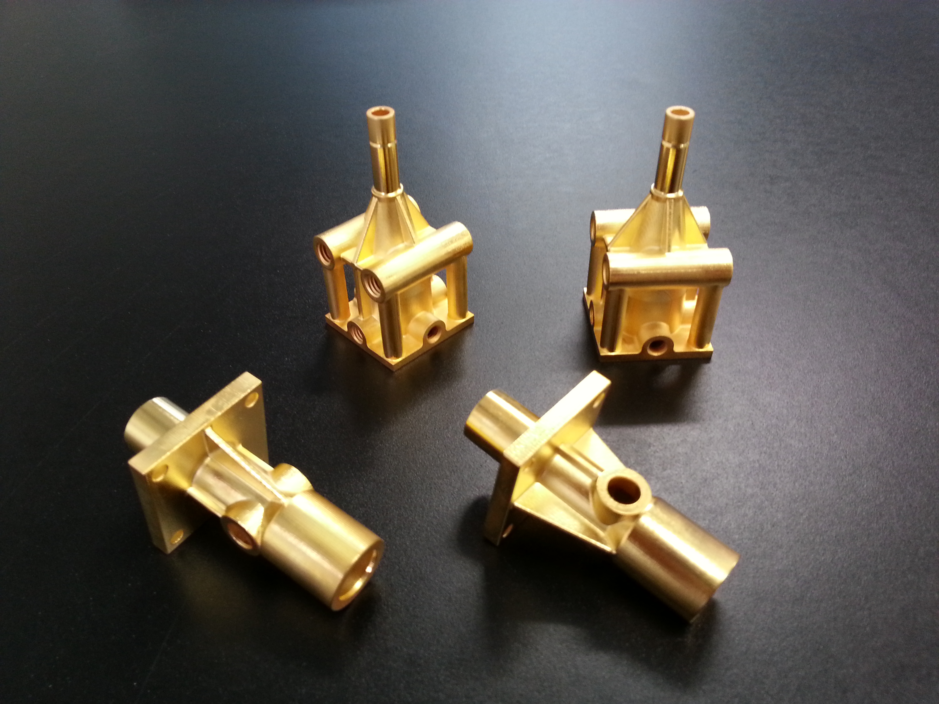 3D printed parts in gold, electroplated by the Swiss company Galvotec, one of few in the world specializing in metal coating for rapid prototyping. Electroplating is used to improve appearance and material properties such as strength and electrical conductivity.
