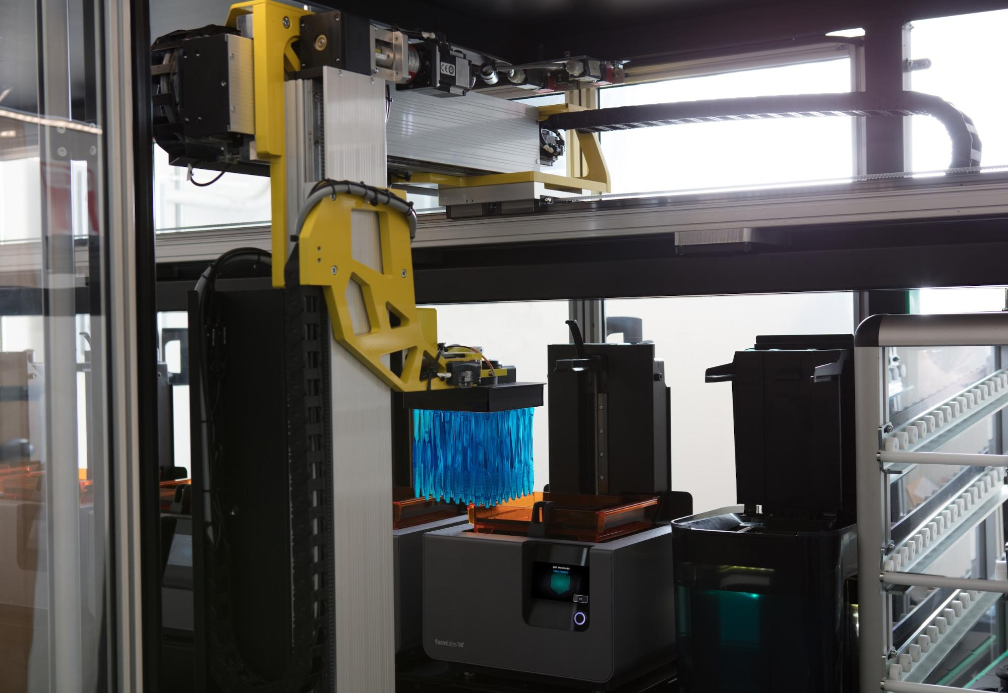 [Form Cell](/3d-printers/form-cell/), a modular production cell developed by Formlabs, uses a robotic arm and gantry system to remove finished parts and clean them in a washing station before placing them on a rack for post-processing, saving considerable human labor.
