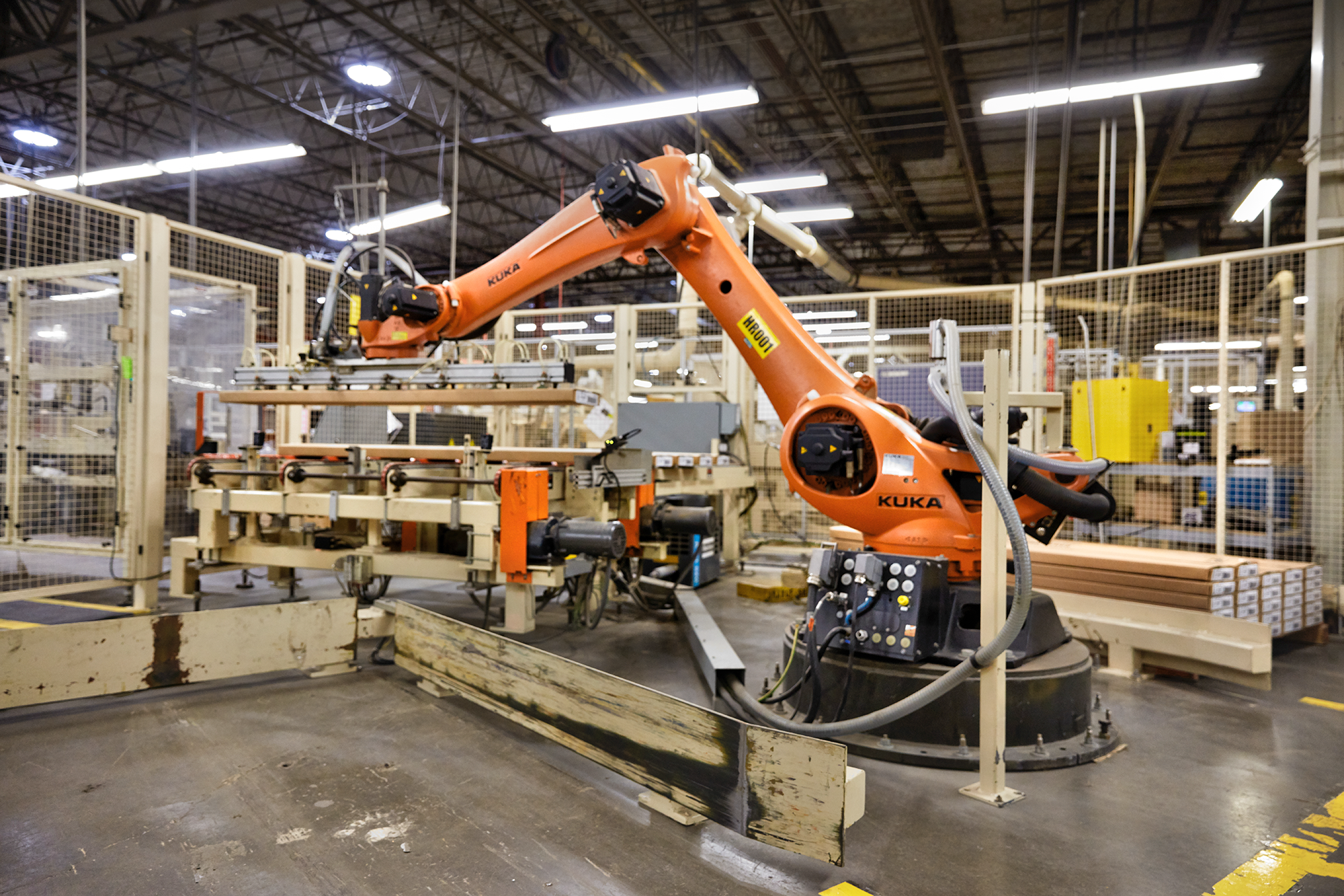 A robot palletizer in Ashley Furniture's factory