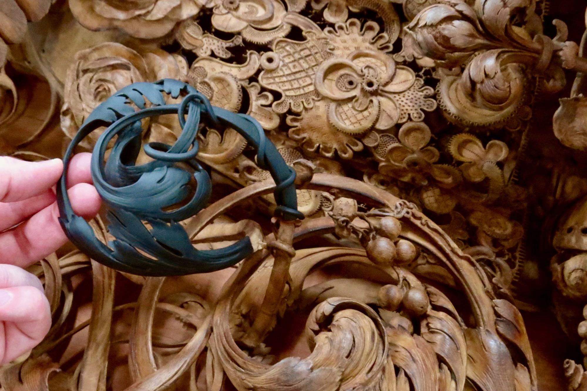 A wood carving restoration right out of the 3D printer. The piece was painted to match the color of the wood before being mounted on the artwork.