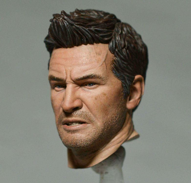 A painted 3D printed miniature of Nathan Drake's head.