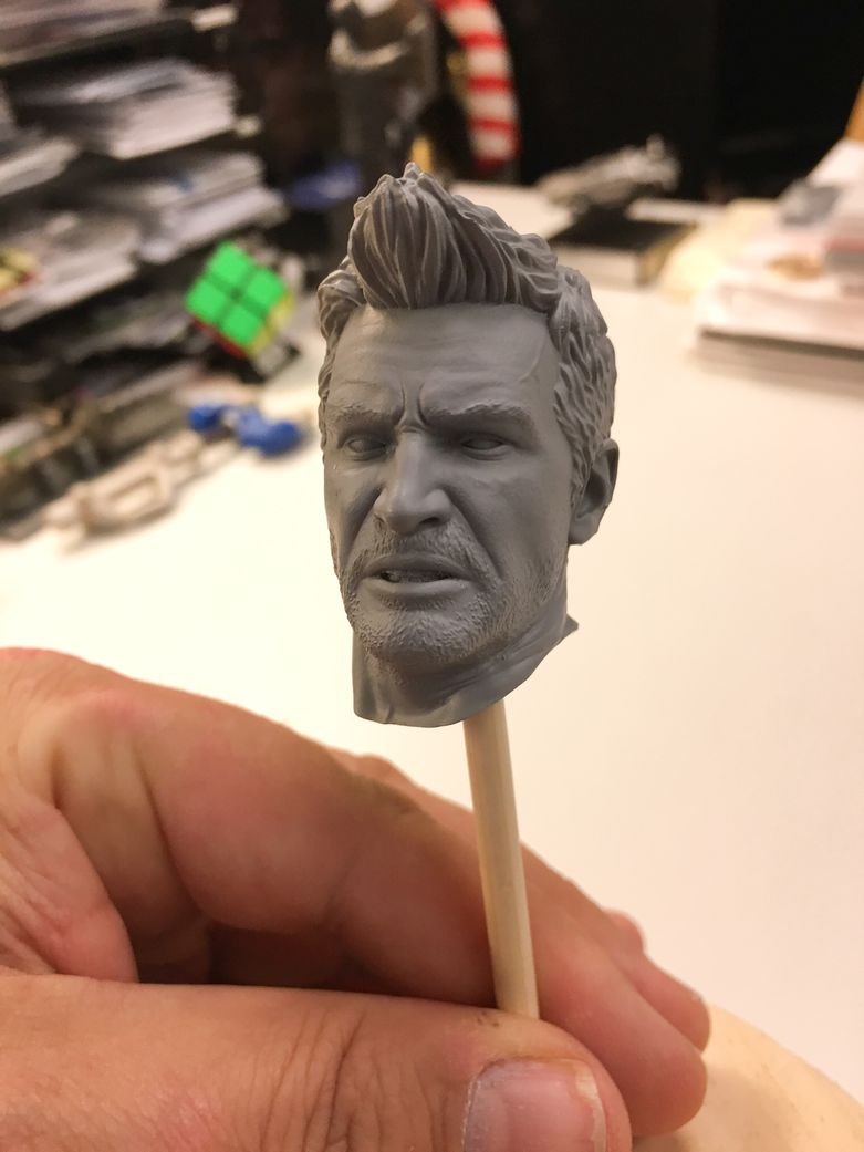 A 3D printed prototype of Nathan Drake's head in Grey Resin.