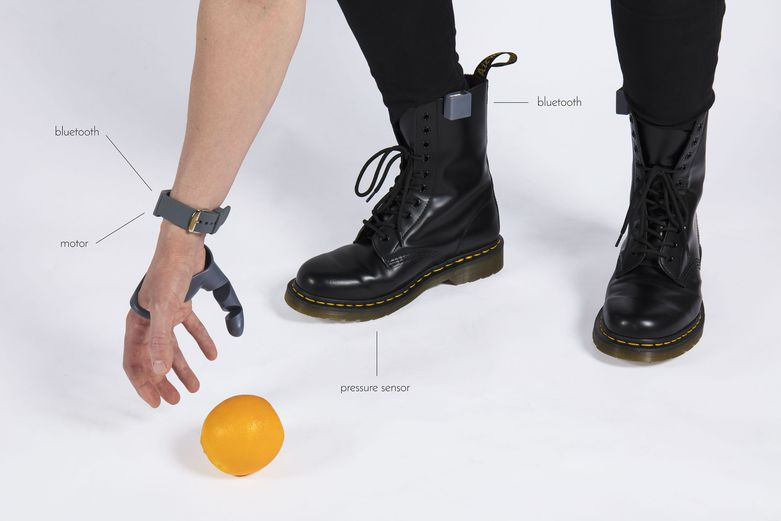 """The Third Thumb"" uses Bluetooth connectivity and a motor in a 3D printed wrist to a pressure sensor attached to the shoe sole."