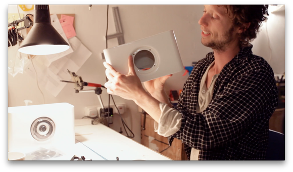 Product designer Yair Neuman examines a speaker prototype in his workshop.