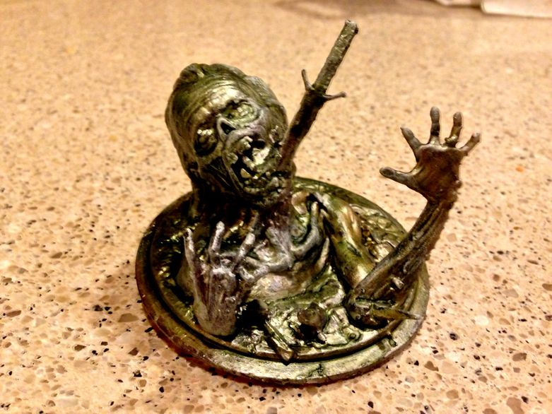 Zombie cell phone stand by John Hamm