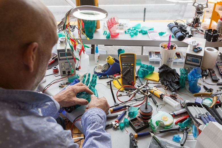 Lyman sits at his workspace assembling bionic hand pieces