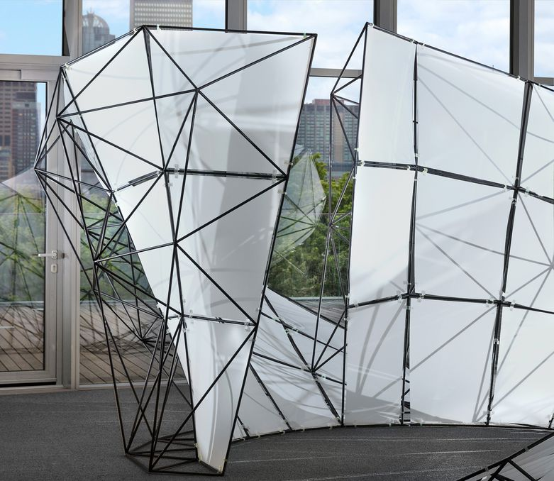 The FUSE pavilion's structural space frame supports its curved surface.