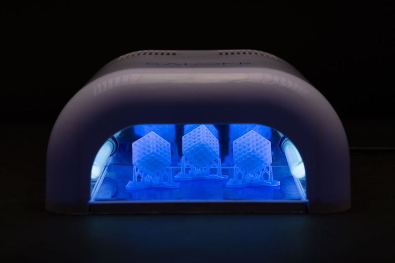 A nail salon UV post-cure chamber