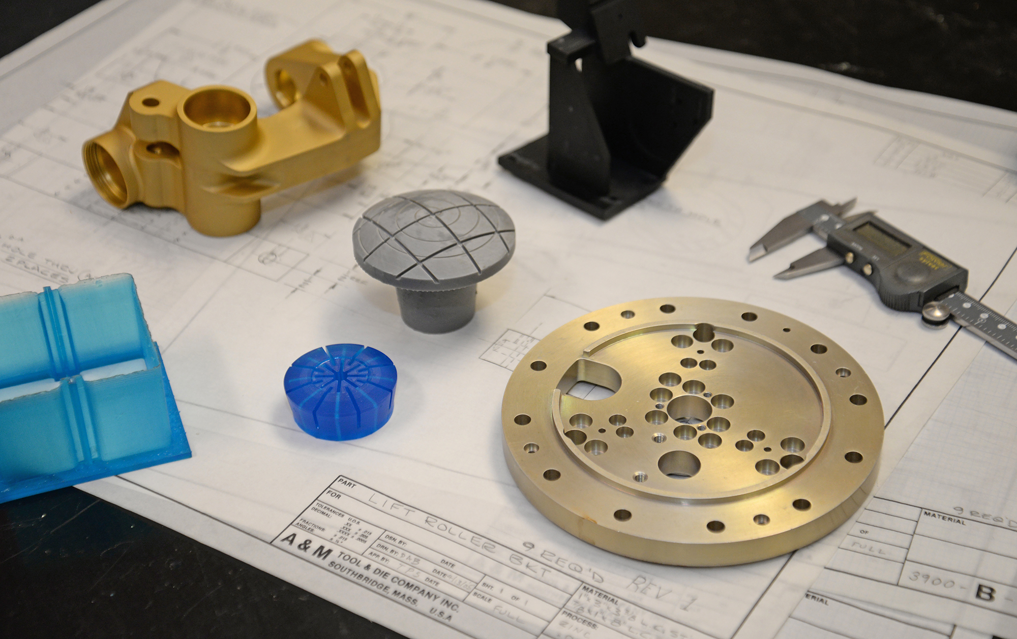 3D printed parts on a desk of a mechanical engineer at A&M Tool.