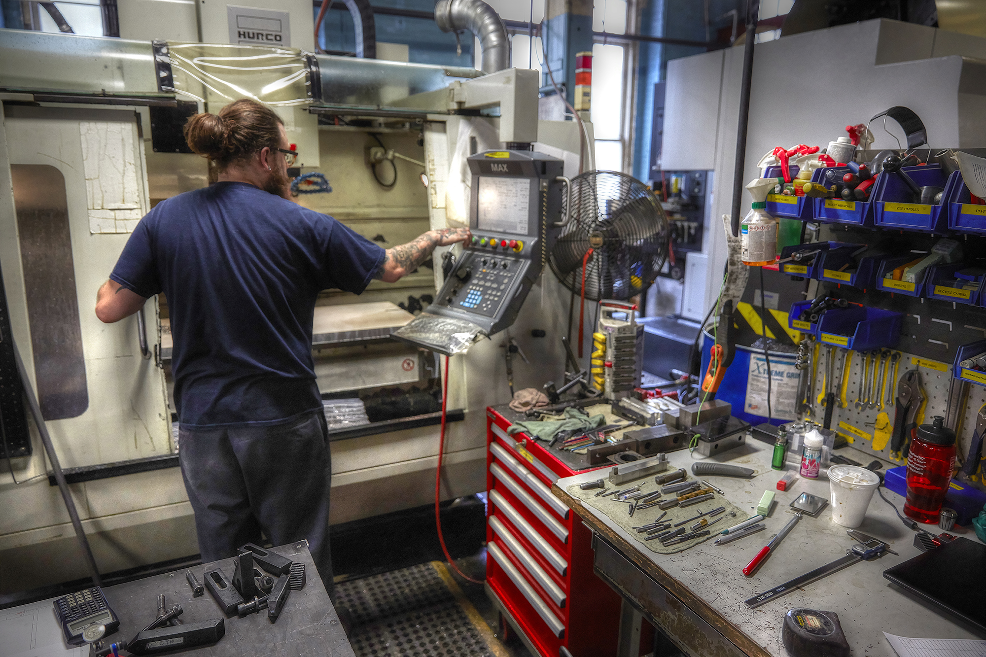 A machinist at A&M Tool operates a CNC mill.