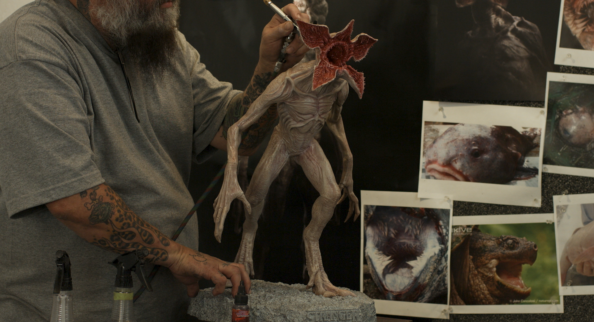 Traditional painting and finishing techniques are used on the final maquette before presenting to directors.
