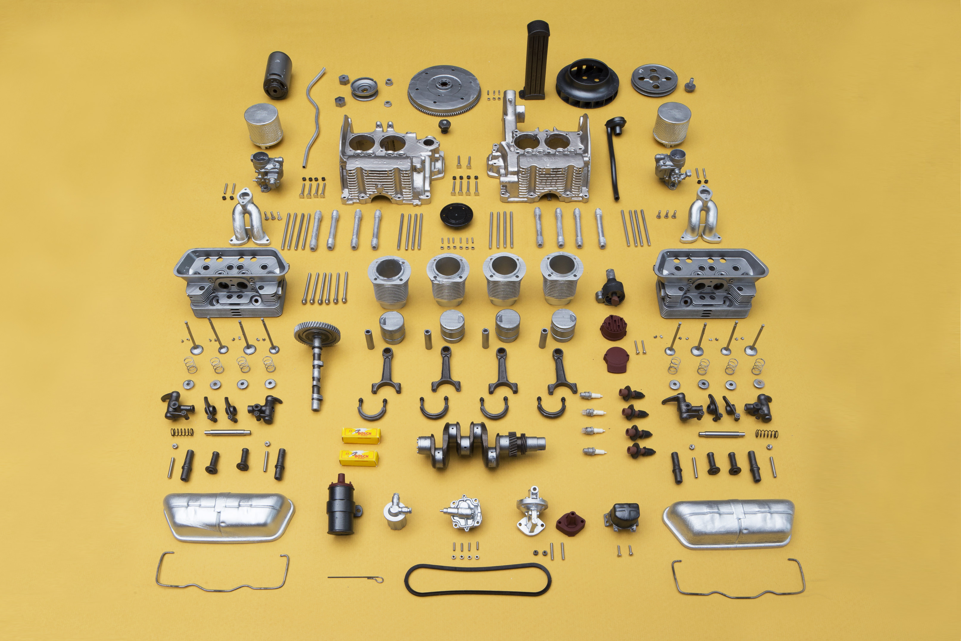Knolling the 250 individual parts of the engine before assembly. The smallest part measures a mere 2 x 1.3 x 0.5 mm, while the largest engine blocks are 60 x 70 x 40 mm.
