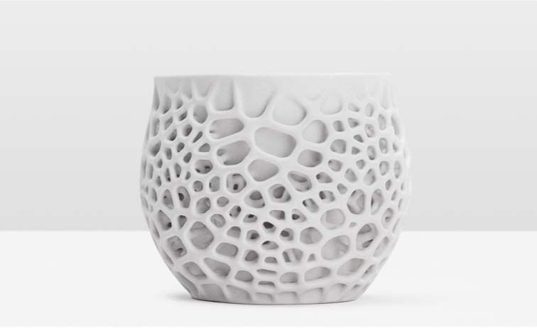 A cup with cellular structures 3D printed in Ceramic Resin.
