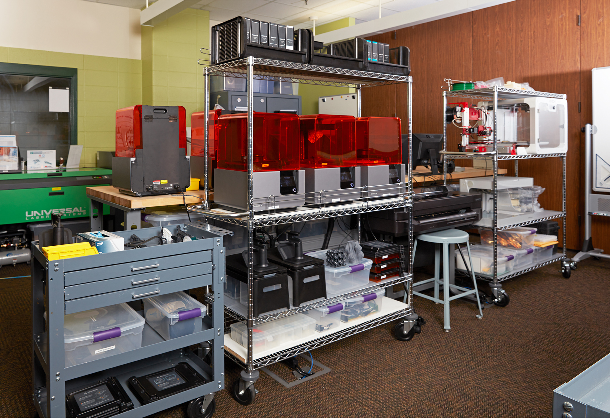 An array of Form 2 3D printers sit on a shelf in Ivy Tech's fab lab.