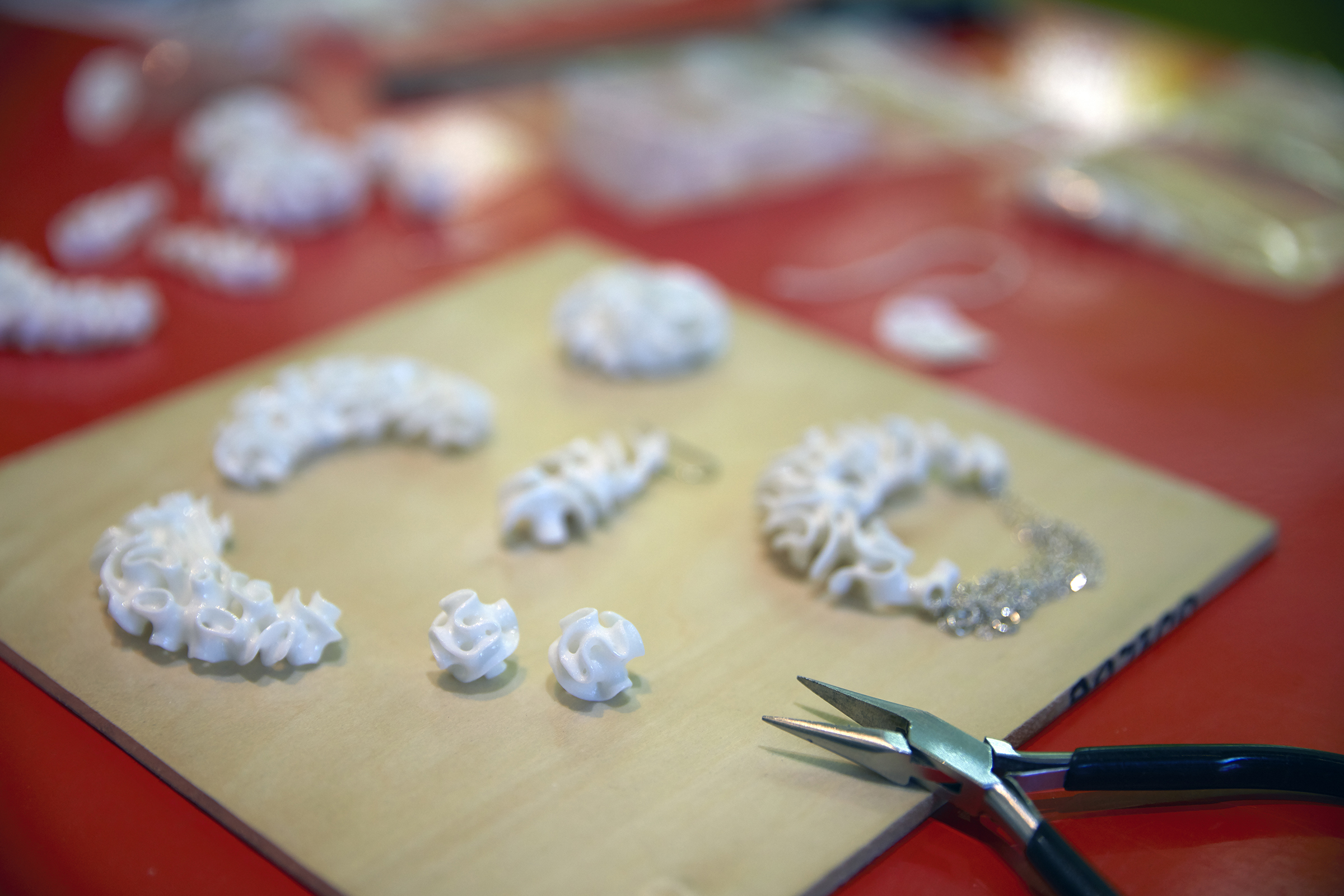3D printed ceramic jewelry in Nervous System's studio.