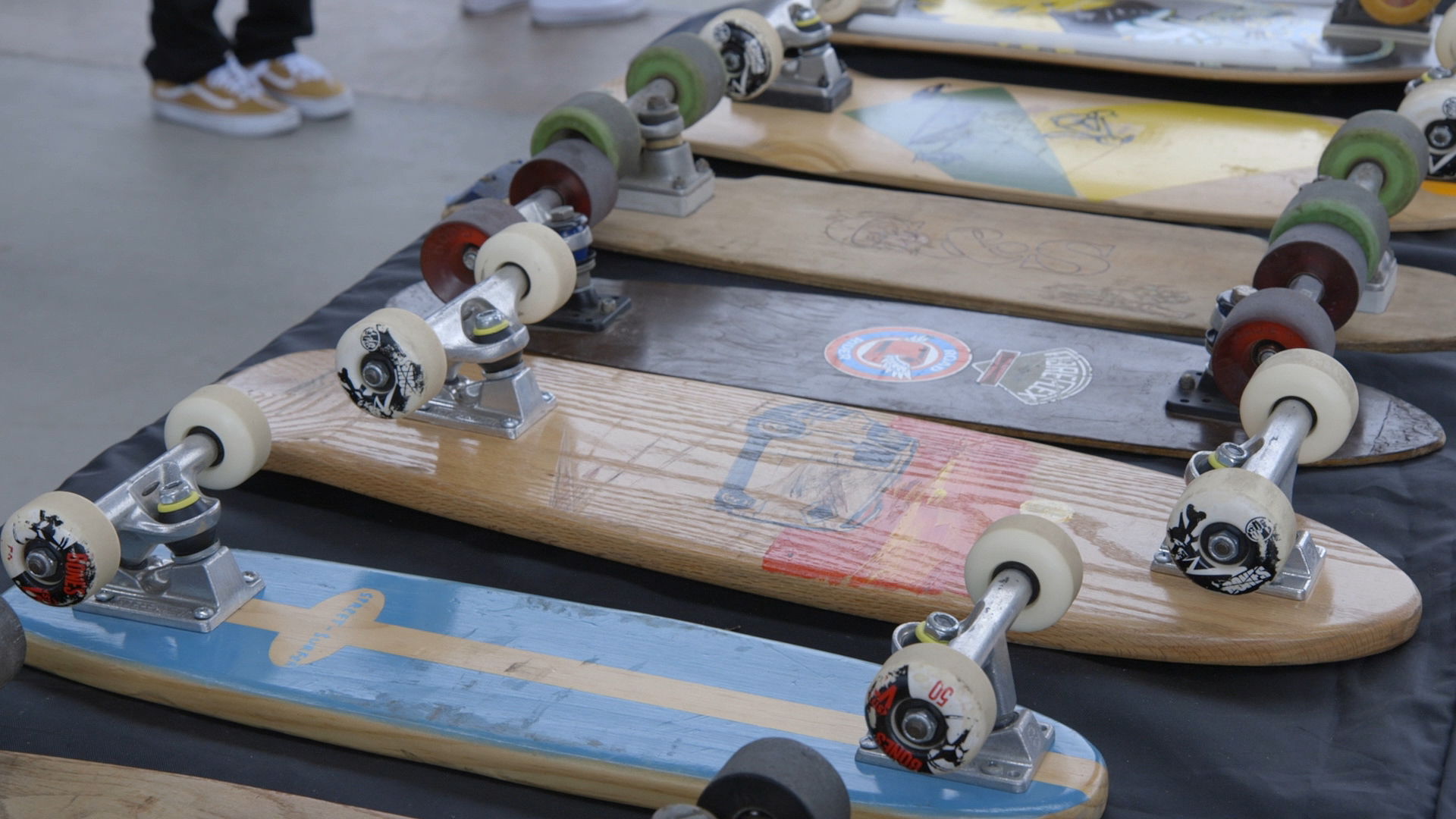 A lineup of skateboards over time, displayed at Innoskate at the Lynch Family Skatepark.