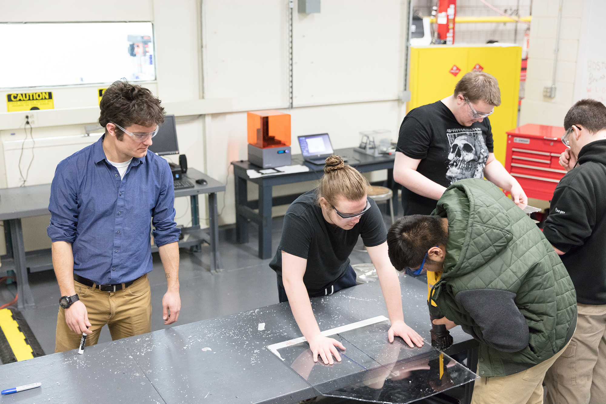 Students work on projects in Somerville High School's fab lab.