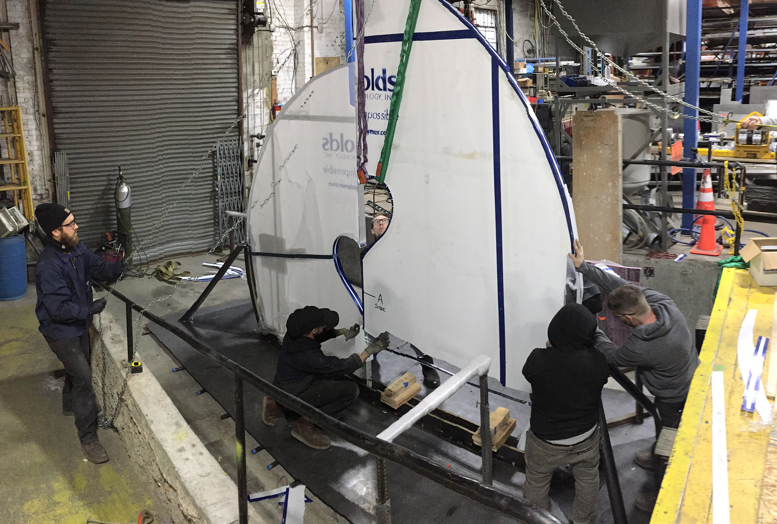 We oriented the sculpture vertically during assembly so we could attach tiles to both sides of the acrylic substrate at the center of the structure at the same time and to avoid having to flip the structure.