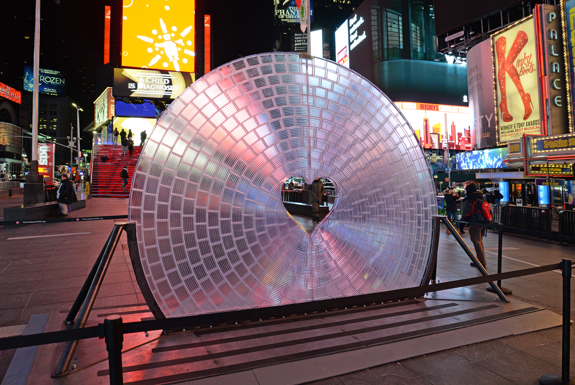 Window to the Heart, a large 3D printed Fresnel lens made of 3D printed bricks, sits in Times Square.